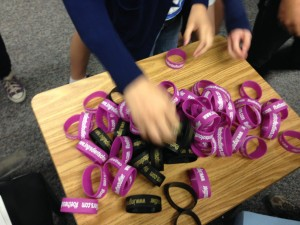 "The students at EDUPRIZE collected their ""#BeTheOutlier"" bracelets."